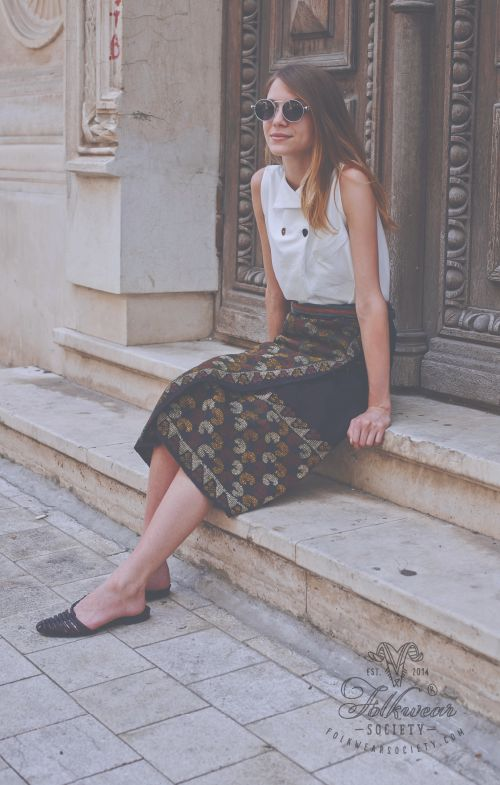 """Adela is wearing an ancient Romanian folk wrap-around skirt called """"fota"""" from the ethnographic area of Muscel. Around 70 years old. Discover more at www.folkwearsociety.com"""