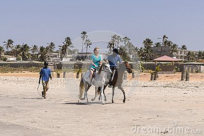 Horseback riding on the beach on the Atlantic Ocean in Gambia. Africa  http://www.gambiatourguides.co.uk/horse-riding.php