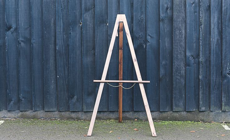 Dark wood, freestanding easel. Ideal for displaying welcome signs, table plans, menus or any other large signage – up to A0 size. Dimensions Height: 140cm