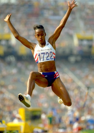 Jackie Joyner-Kersee ~ first American to win gold for the long jump Flo Jo's sister in law who in her own right was an incredible athlete took a back seat to her Sister In Law partly because of even back then VAIN individuals who did not think she was attractive enough for endorsements