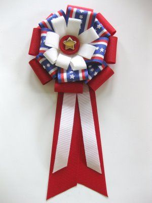 Prize Ribbon - for the Pie Bake off at church.  Made 4 during naptime in assorted colors.  Nice to use up some ribbon I've been storing.  Good tutorial.