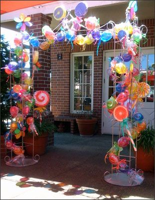 The venue was a garden patio filled with oversized candy and lollipops.