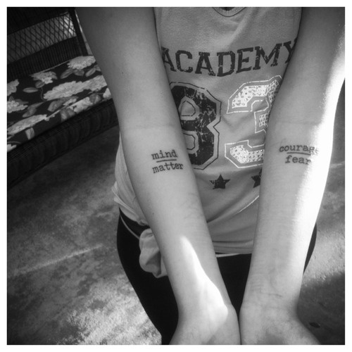 courage over fear tattoos