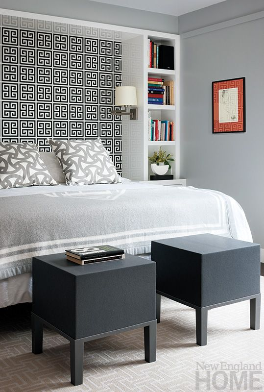 A recessed wall, covered with Greek Key–pattered paper in a nod to the homeowners' heritage, forms the master bed's headboard.