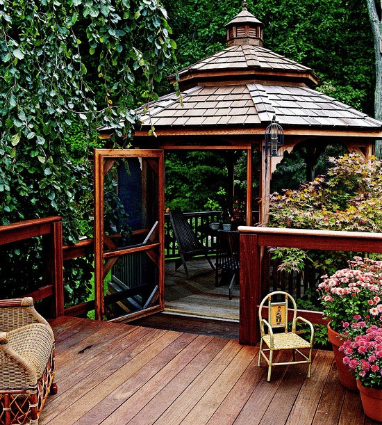 Enhance your deck with a gazebo of dark, rich Brazilian ipe wood; use planks of a lighter wood for flooring. The screened room provides a convenient location for bug-free outdoor dining.(Better Homes and Gardens)