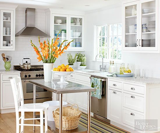 Think your small kitchen can't accommodate an island? Think again. An open cart, like this beauty from a restaurant supply store may be your answer to more storage and workspace. Be sure to measure your kitchen and choose a size that still leaves plenty of walkway space. And look for a cart on wheels that can be moved around as needed.