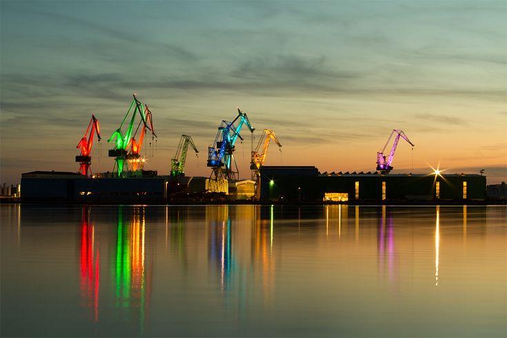 Illuminated Shipyard Cranes Transform Into Glowing Origami Dancers