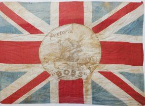 """South Africa - War memorabilia featuring flags Above in an artistic flight of fancy, home-based war artists are always behind the times about what's really going on the battlefield.  Bobs wields a sword in a most un-Boer War like manner. """"There they are lads; Go get em."""" It was enough to make any red-blooded Englishman burst their britches with, well, pride... (Anglo Boer War Museum). William Garrison, 13 Mar 2013"""