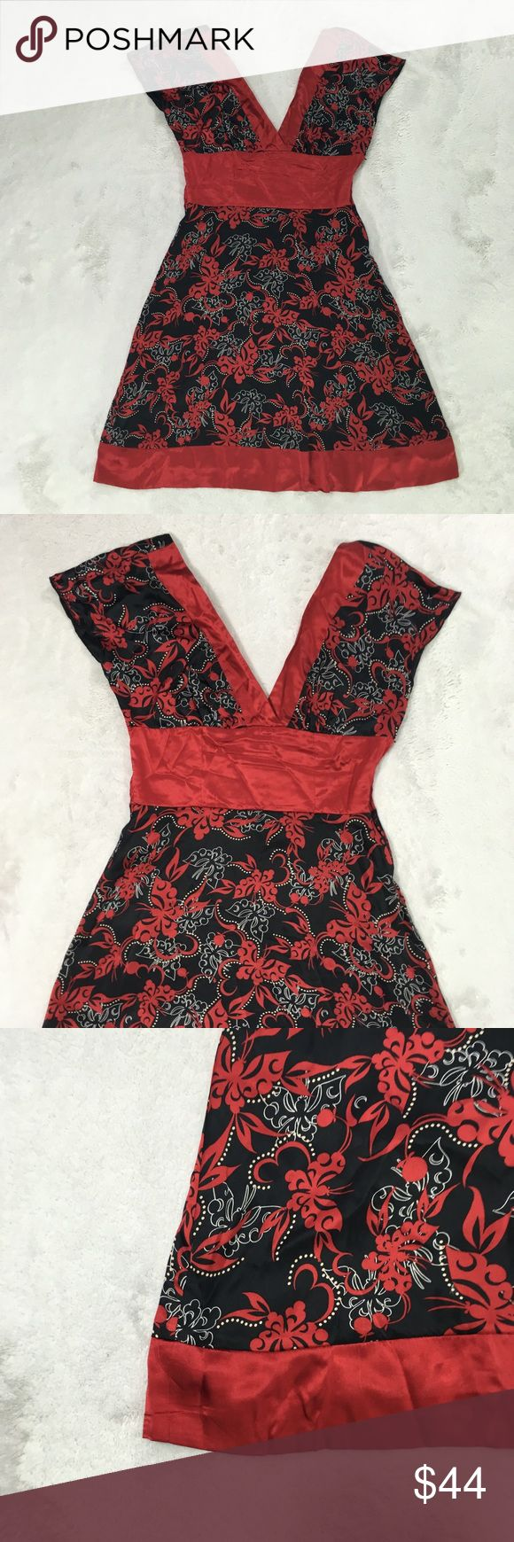 """Bebe black red and white 100% silk dress SMALL Beautiful dress by Bebe. Small. Silk. Very soft to the touch.   Asian looking pattern of butterflies I believe  Has a tie for across the back top- fully lined  Approx measurements when laying flat are  16"""" across bust  14"""" across waist  38"""" from top of shoulder down- length  Perfect holiday or party or going out dress bebe Dresses"""