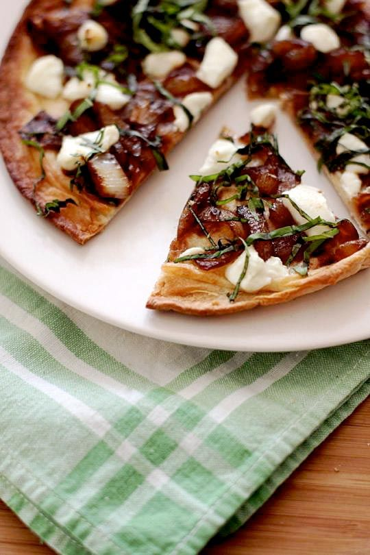Flatbreads with Goat Cheese, Caramelized Onions, and Basil.  Here's a recipe that can easily work both as a party-worthy appetizer or as a light supper, perhaps served with a salad dressed in a sharp, mustardy vinaigrette. The sweet caramelized onions, sharp goat cheese and pungent fresh basil work together beautifully, especially when supported by a crisp but chewy Flatbread.