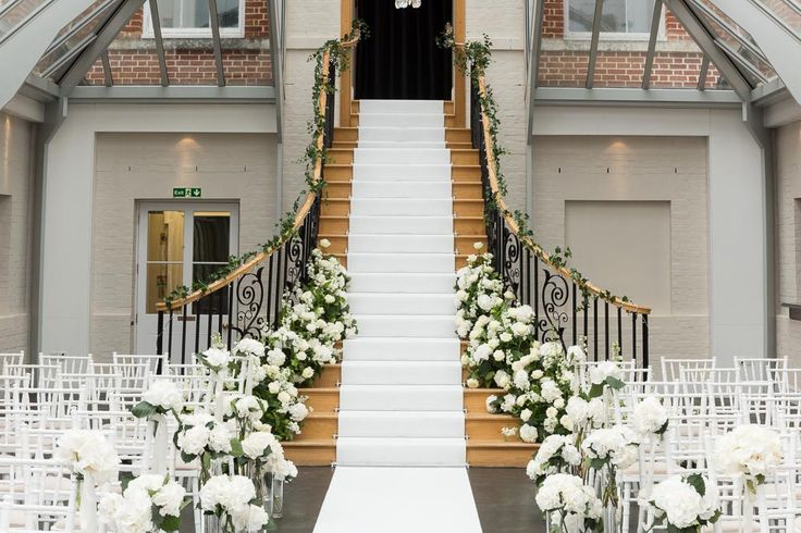 The beautiful staircase at Botleys Mansion. Wedding Flowers