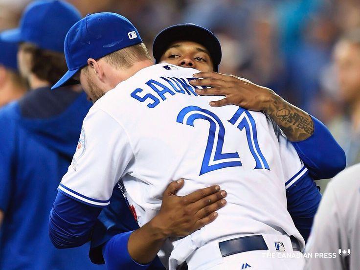 Jays hugs Stroman & Saunders