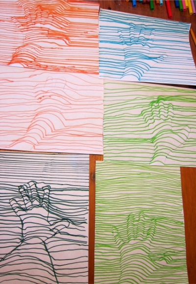 Kids did these!!!  Trace the hand in pencil. With a marker, draw a straight line until you get to the hand. Then make a curve from one line to the next, then continue the straight line.