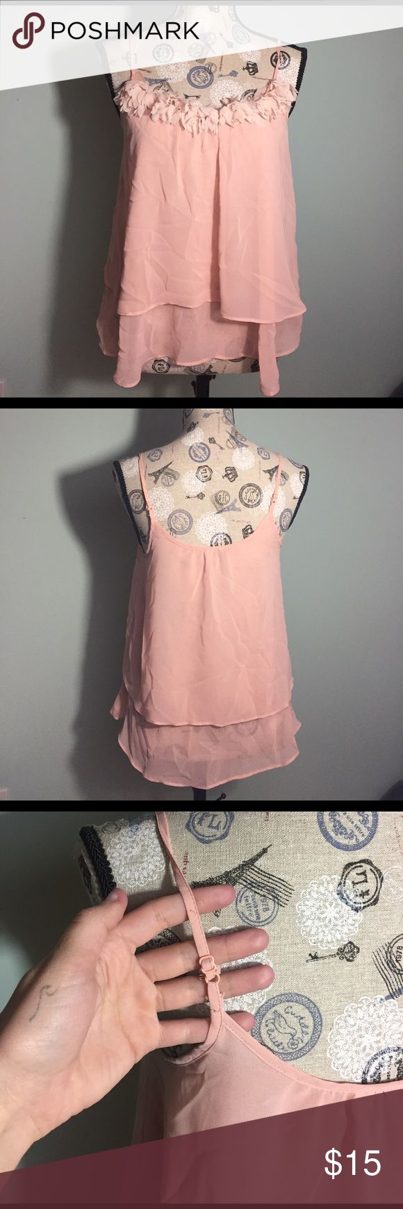Baby pink tank top with frills This pink tank top is perfect to wear with a pair of jeans and some wedges for a girls night out. The fabric is light and airy for the summer time of can be paired with a sweater for a cute fall outfit. The tank is in perfect condition and has working adjustable straps as well! LC Lauren Conrad Tops Tank Tops