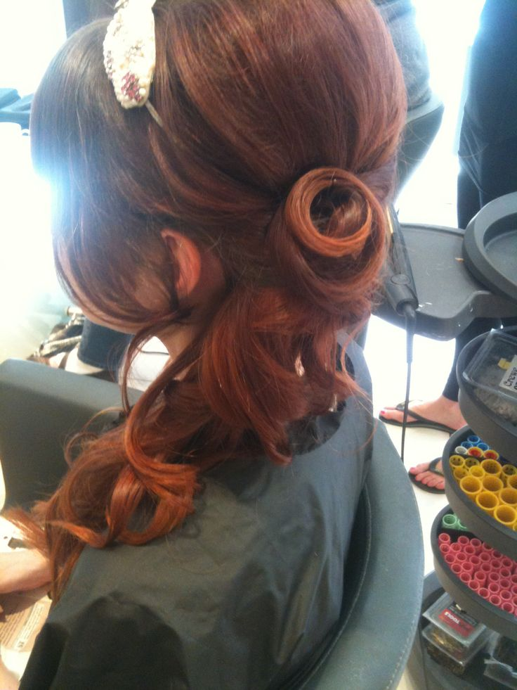 Curled side ponytail