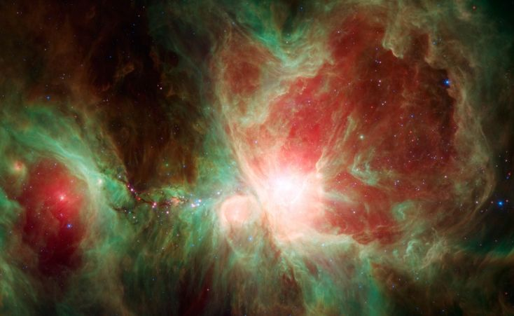 Few cosmic vistas excite the imagination like the Orion Nebula, an immense stellar nursery some 1,500 light-years away. This stunning false-color view spans about 40 light-years across the region, constructed using infrared data from the Spitzer Space Telescope.