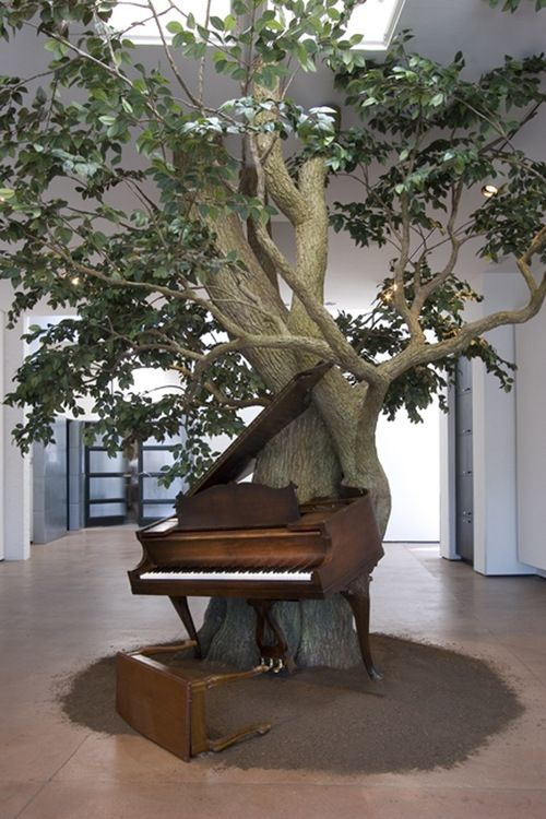 "Sanford Biggers  Blossom   2007  Silk steel, wood, MIDI player piano system, Zoopoxy (approximately 12ft x 18ft x 15 ft).  * Blossom consists of a player piano that performs the original arrangement of ""Strange Fruit"""