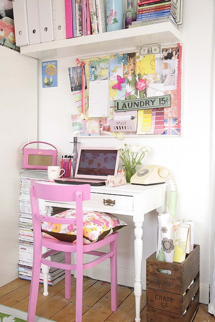 Adore the pink chair in this little office.