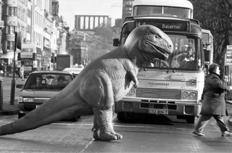 A Tyrannosaurus Rex crosses Princes Street in 1990 as part of the 'Dinosaurs Alive!' exhibition in Edinburgh.