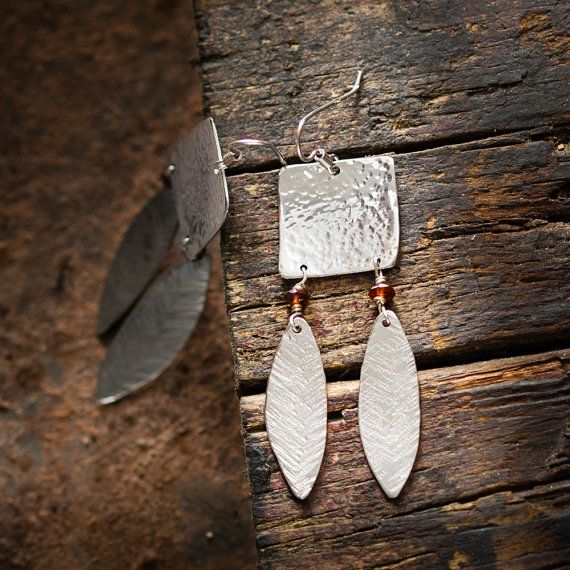 Handcrafted earrings pair, totally handmade.    In hand hammered and rhodium-plated sterling silver, with garnets.