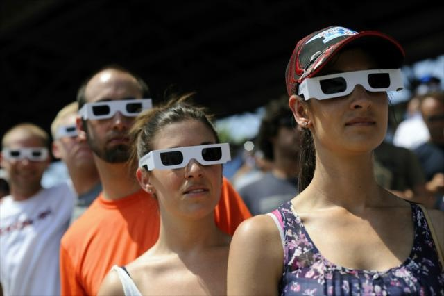 Fans wear white sunglasses in memory of Dan Wheldon, two time winner of the Indianapolis 500, at the Indianapolis Motor Speedway.