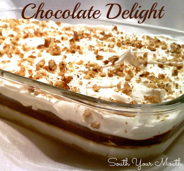 Chocolate Delight  ------------------  Scrumptious layered dessert with a homemade pecan crust, cheesecake layer, chocolate pudding layer, and topped off with whipped topping and pecans.
