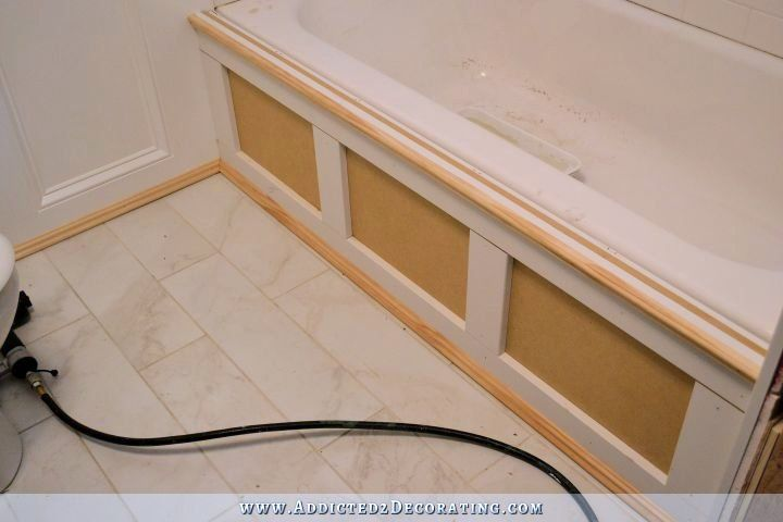 DIY tub skirt - step 5 - add vertical trim and decorative moulding along top and bottom