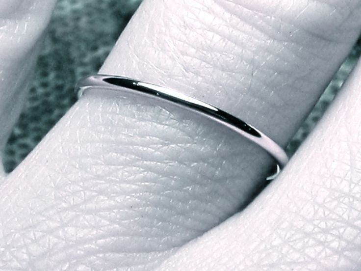 thin WHITE gold wedding band solid 14k full round ring classic dainty smooth simple organic skinny stacking band. $128.00, via Etsy.