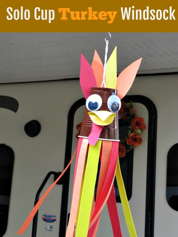 Add whimsy and fun to your Thanksgiving decor and make some memories with the family with this turkey craft for kids. With a brown solo cup, some construction paper, and a few other supplies create this adorable turkey windsock. by PenneyLane.com