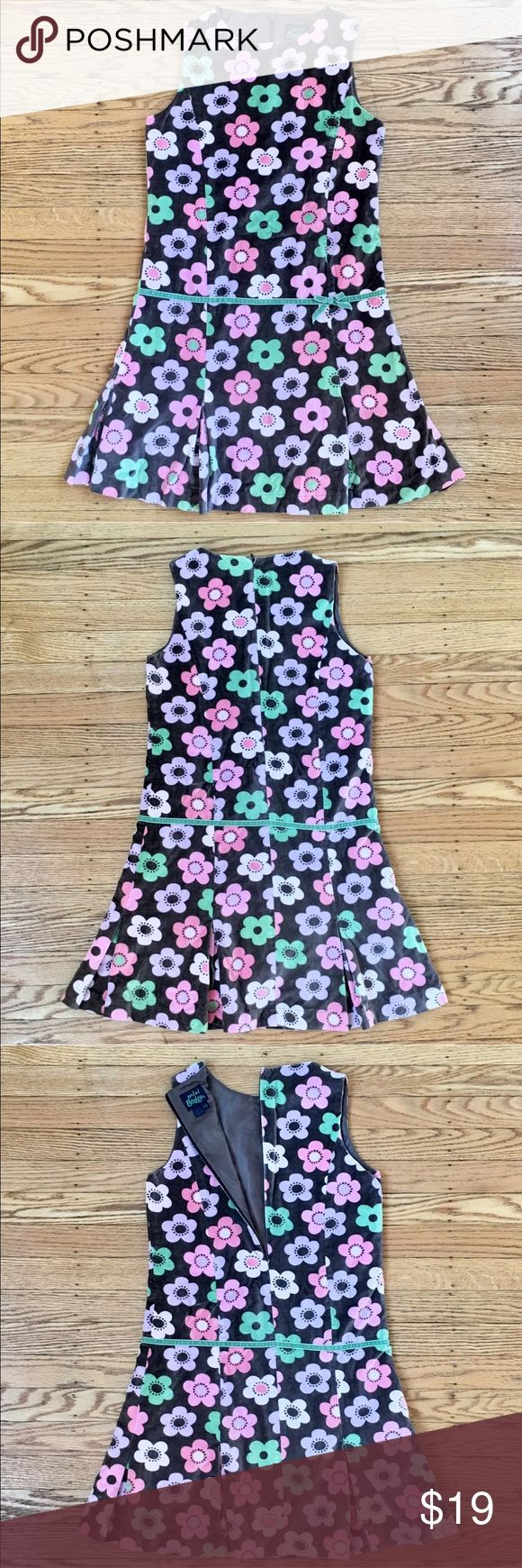 Mini Boden Velvet Party Dress 11/12 Yr Mini Boden  Girls 11/12 yr  Sleeveless  Hidden Back Zip  Pull Over Style  Velvet 100% Cotton Taupe Shell with MultiColor Flower Print Dress.  Cute Bow Accent.  Lined  Pleated Skirt.  Thank You!  PreOwned in Excellent Condition  Perfect Paired with Cardigan and Tights ❤️ Mini Boden Dresses Formal