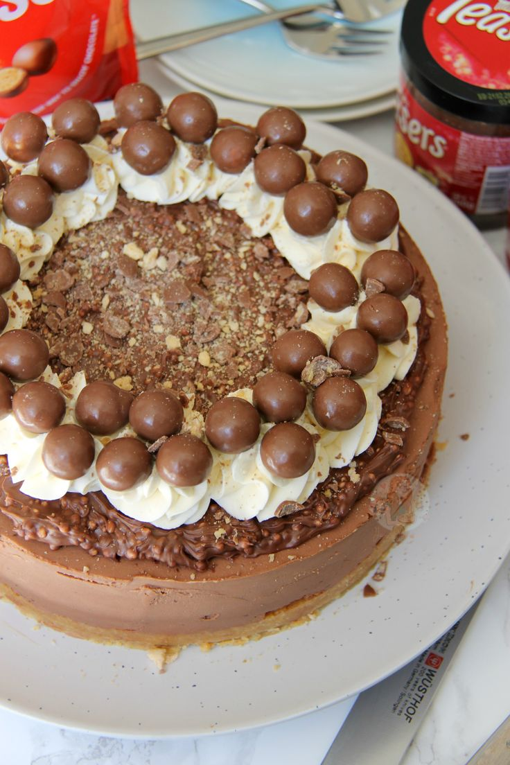 Delicious & Chocolatey Malteser Cheesecake – Malt Biscuit Base, Chocolate Malt Cheesecake, Malteser Spread, Sweetened Cream, and Maltesers! Perfect Showstopper for any occasion! This cheesecake is SO delicious chocolatey and moreish – that I ate the whole thing myself with a fork. I'm kidding. (I wish) Anywayyyy… I have had so many requests for Malteser Cheesecake that I have literally lost count – after the success of my No-Bake Caramel Rolo Cheesecake I thought I would oblige! I did thi...