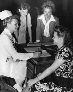 "9-15-1947 - ""Women register for practical nursing course"" :: George D. McDowell Philadelphia Evening Bulletin - Nurse Josphine Bacauskas is registering Mary Pack for a practical nursing course. The other women pictures are Dorothy Roney (left) and Catherine Grant (right). The registration was held at the Fleisher School."