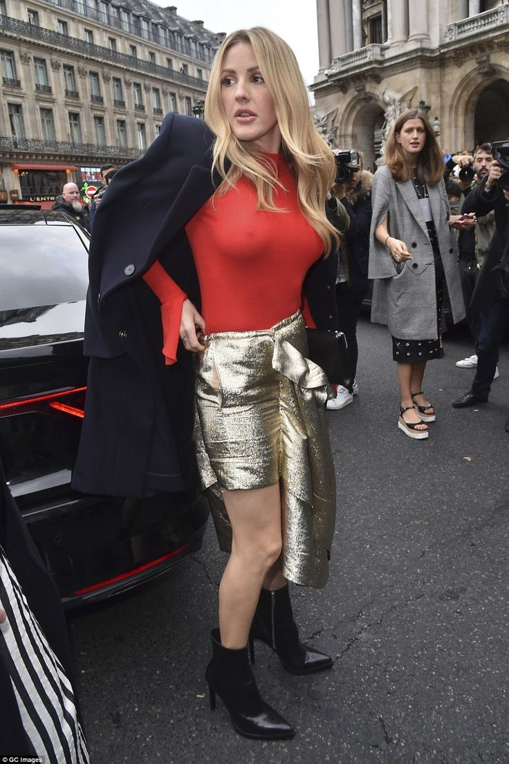 Red hot: Ellie Goulding has taken her fashionable displays a step further as she showcased her enviable figure in a vibrant skintight body while attending the Stella McCartney SS18 runway show during Paris Fashion Week on Monday