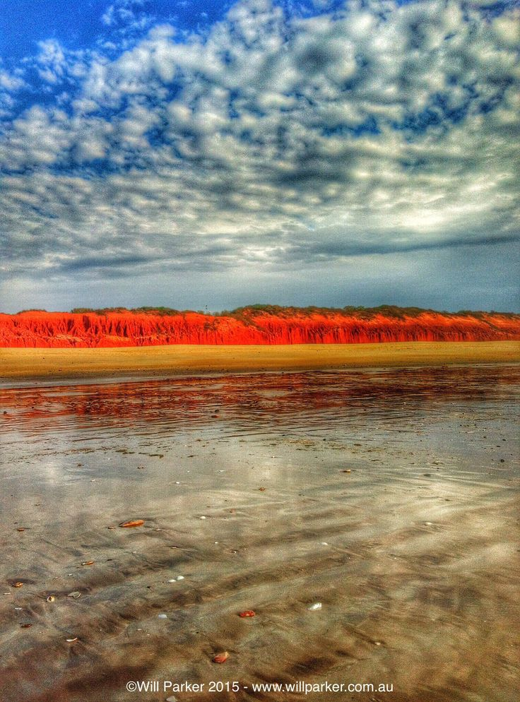 Endless lines of Pindan Cliffs highlight the beach at Barn Hill Station, The Kimberley Western Australia.