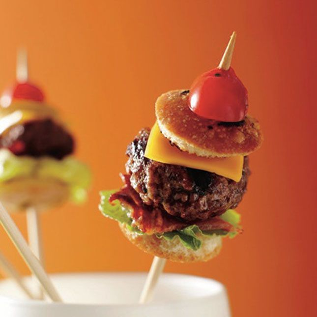 """100 Things You Can Serve On A Stick """"Does it get any cuter, more Pinteresting, or cocktail-friendly than cake pops, kabobs, and popsicles?""""  Pictured:  burger on a stick"""