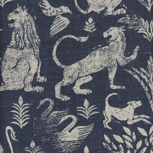 City of Lions Fabric A striking linen union fabric inspired by renaissance tapestries and featuring lions, huntings dogs, swans & birds set against a woodland backdrop. Hand silkscreened in indigo woad on a natural ground.