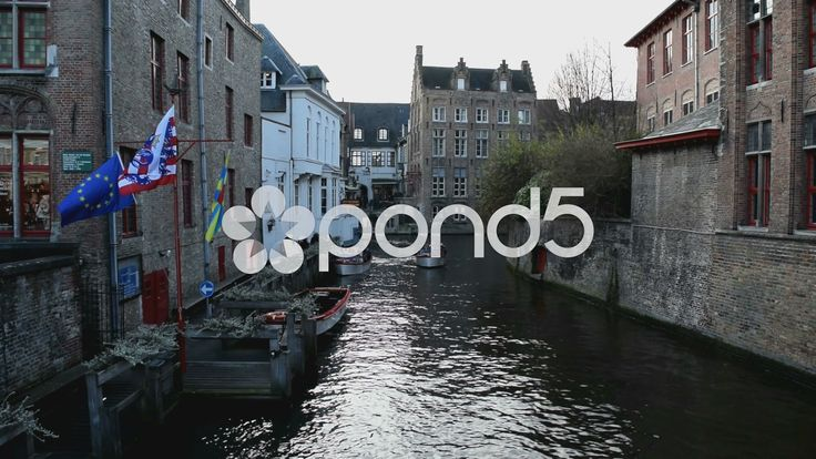 "Bruges, Belgium. Canal with boats & flags & hotel from the movie ""In Bruges"" - Stock Footage 