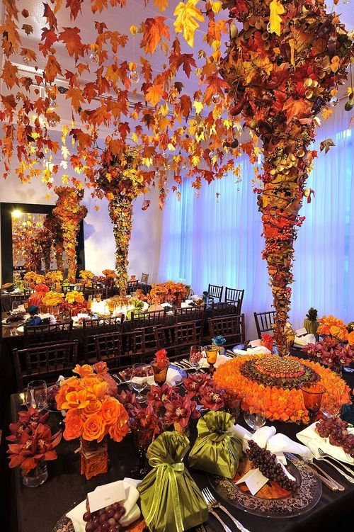 """autumn leaves strung from nylon rows on ceiling create odd canopy over this dining table setting. could use inspiration for other looks. Go Big or Go Home  """"Go big or go home,"""" I think is the motto of this extravagant table.  Check it out at Preston Bailey."""