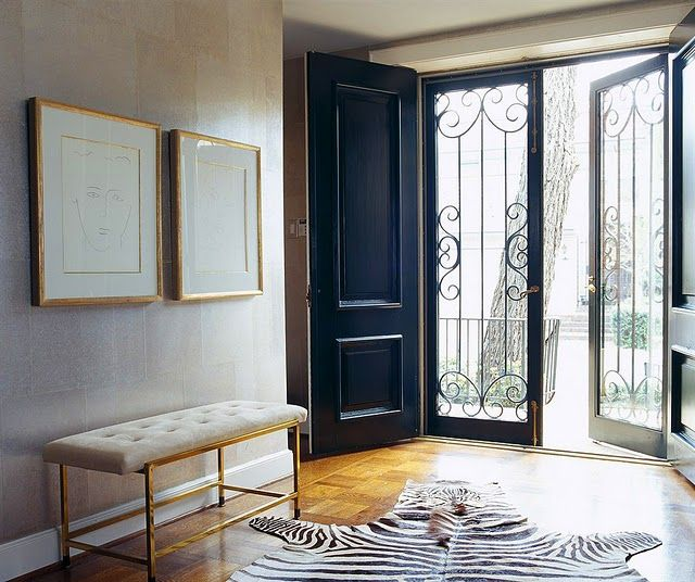 Design Chic - could this entry be any more beautiful - love the black doors and zebra rug