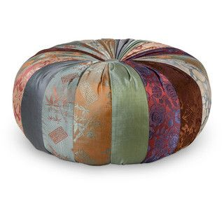 Sometimes our bodies need a little gentle help when entering and exiting yoga poses. Keep your hips lifted and knees happy with this luxurious yoga pillow crafted from a shiny patchwork of rich fabric.  Matching pillow.