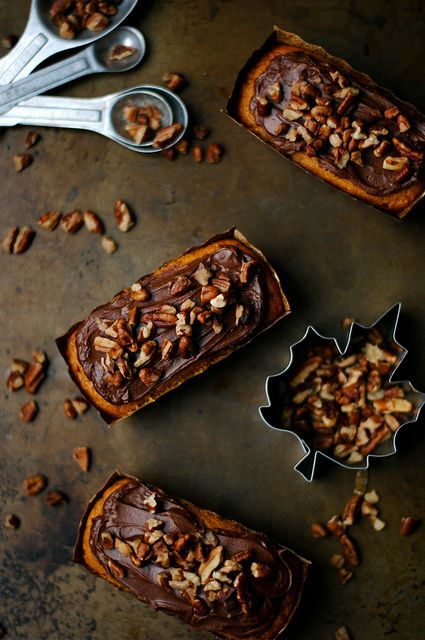 Mini pumkin cakes with chocolate frosting and pecans