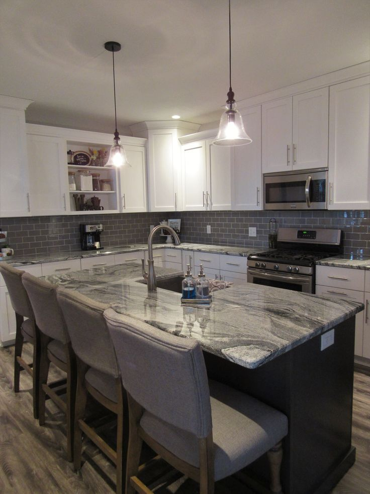 White shaker cabinets, gray subway tile and beautiful viscount white granite were the perfect ingredients for this modern farmhouse kitchen.