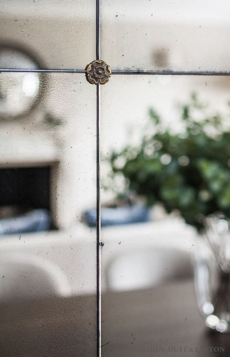Detail of antique mirror panelling with brass stud in dining area. #GD&LBespokeFurniture