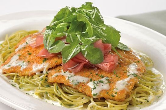 Cheesecake Factory's Chicken Bellagio Recipe ~ Crispy Coated Chicken Breast over Basil Pasta and Parmesan Cream Sauce Topped with Prosciutto and Arugula Salad. Recipe shared by The Cheesecake Factory