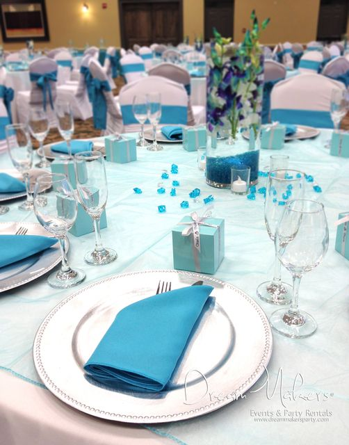 Lovely table settings at a turquoise wedding party!   See more party ideas at CatchMyParty.com!