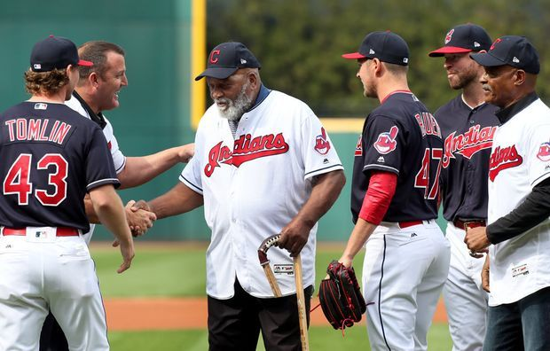 Indians great Jim Thome shakes hands with Browns legend Jim Brown after the two threw out the ceremonial first pitch, along with Cavs great Austin Carr, at he Cleveland Indians home opener against the Chicago White Sox on Tuesday, April 11, 2017. (Chuck Crow/The Plain Dealer)