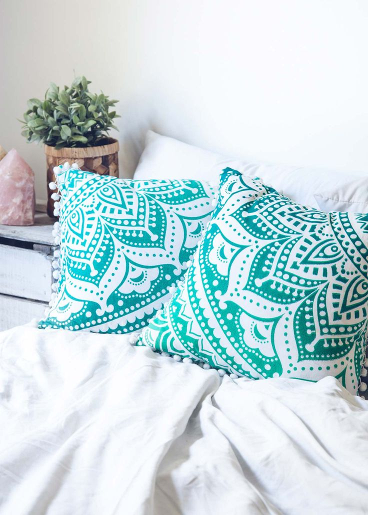 Add a hypnotic splash of color to your bed or living room with these bold, blue and green mandala patterned cushion covers. Mix and match these with our Medallion Tapestries to really set the mood! -