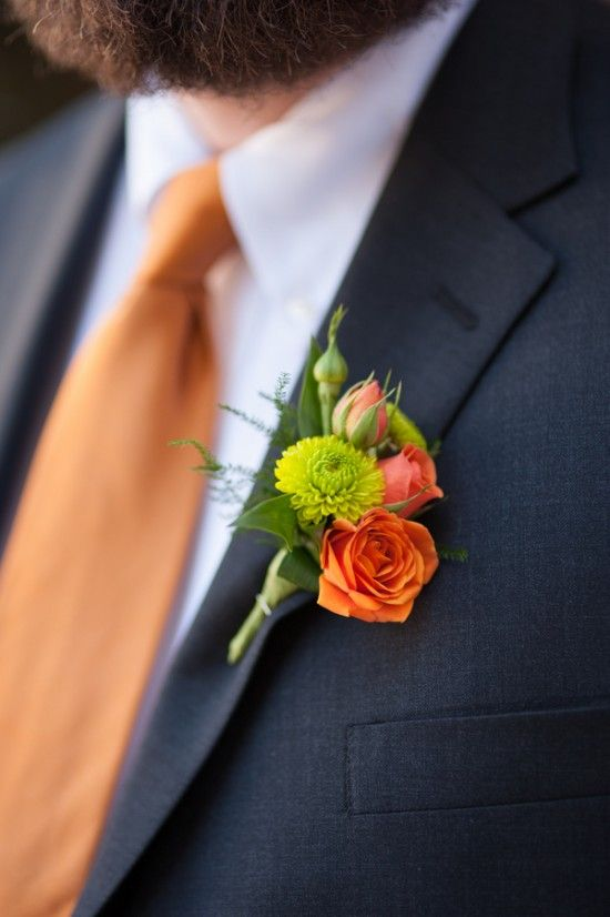 Orange spray rose and chartreuse mini chrysanthemum boutonniere.