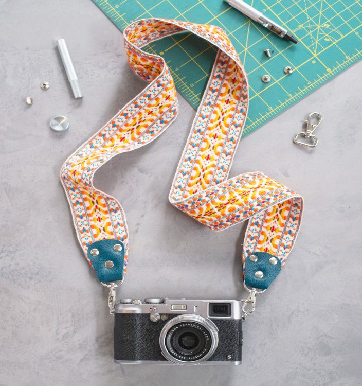 Expressing yourself is a snap with this DIY camera strap. Using a length of vintage-style trim, durable leather, and a few hardware pieces, we'll show you how to add individuality to your camera while keeping it safe and secure around your neck or shoulder.
