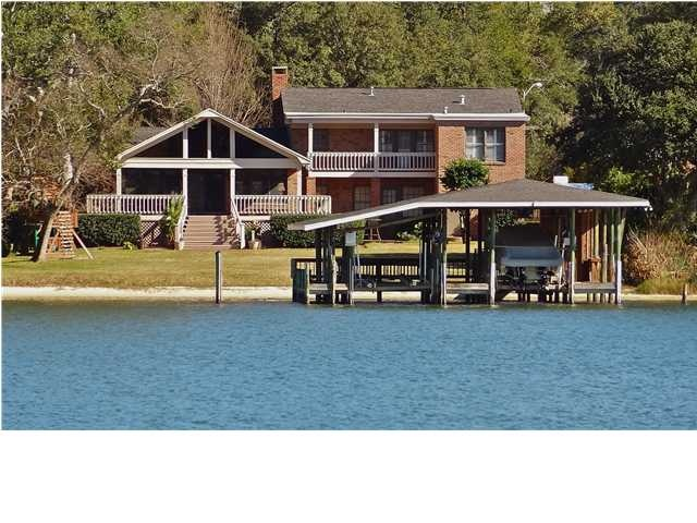 A rare find - prestigious Birnam Woods home with 115' on Bayou Texar providing wonderful panoramic water views. Banquos Trail is one of the most beautiful streets in Pensacola - lined with lovely oak trees and stately homes. The lot here is one of the deepest lots in Birnam Woods with 350' at it's deepest point, fairly level and has .61 acres. Click the picture to see more images of this beautiful property that includes a dock with boat lift! Many like this don't come along, take action…